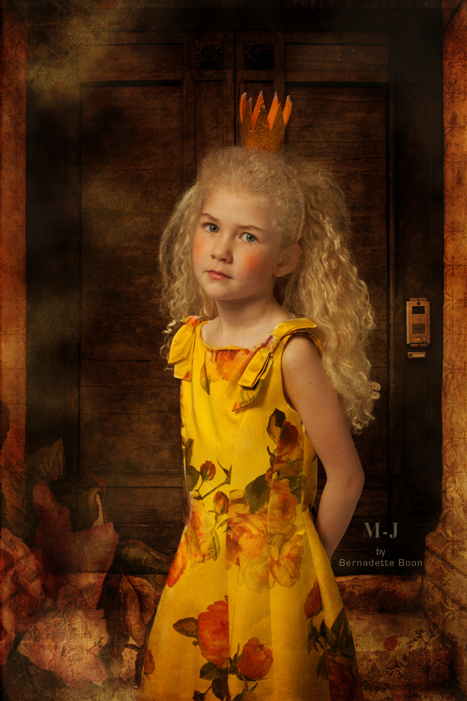Magisch kinderportret in herfstkleuren, met blonde krullen